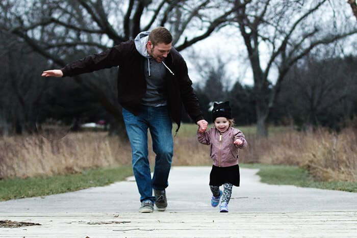 Father and daughter walking in the park